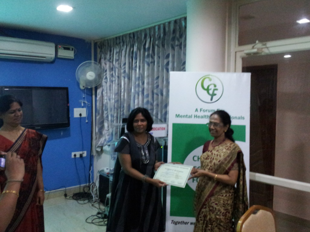 Surya receiving the Certificate on completion of Barefoot Counselors Workshop @CCF